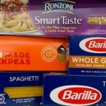 A variety of spaghetti brands and types on a store shelf.
